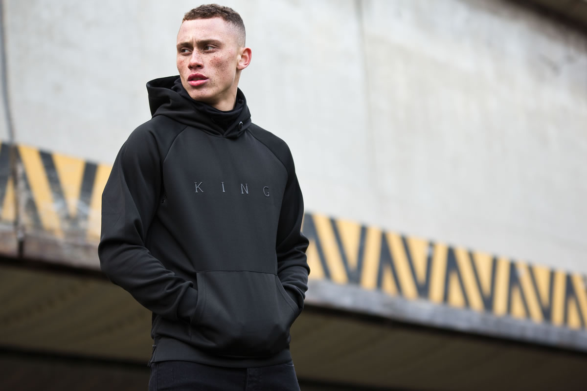 Model wearing black AW17 King Apparel hoodie