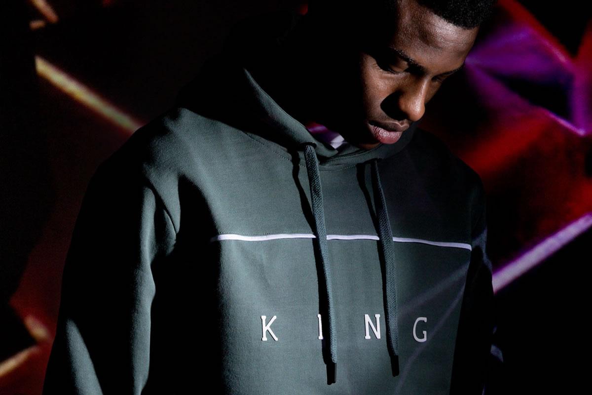Model wearing fern AW18 King Apparel Stepney hoodie