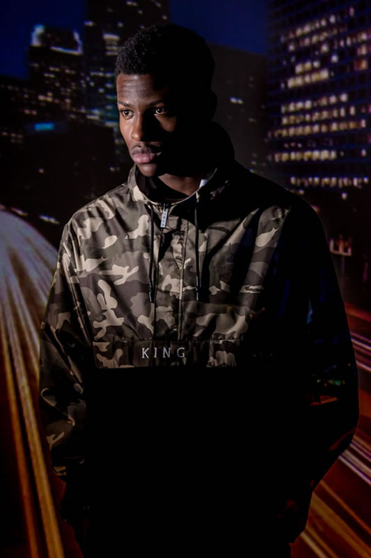 Model wearing camo AW18 King Apparel Theydon windrunner jacket