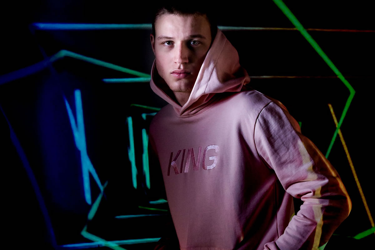 Model wearing blush AW18 King Apparel Wapping tracksuit hoodie