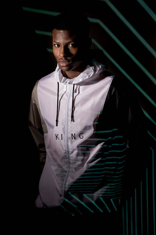 Model wearing white AW18 King Apparel Theydon windrunner jacket