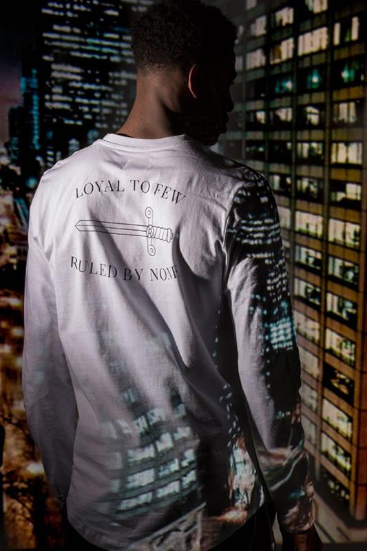 Model wearing white AW18 King Apparel Earlham longsleeve t-shirt