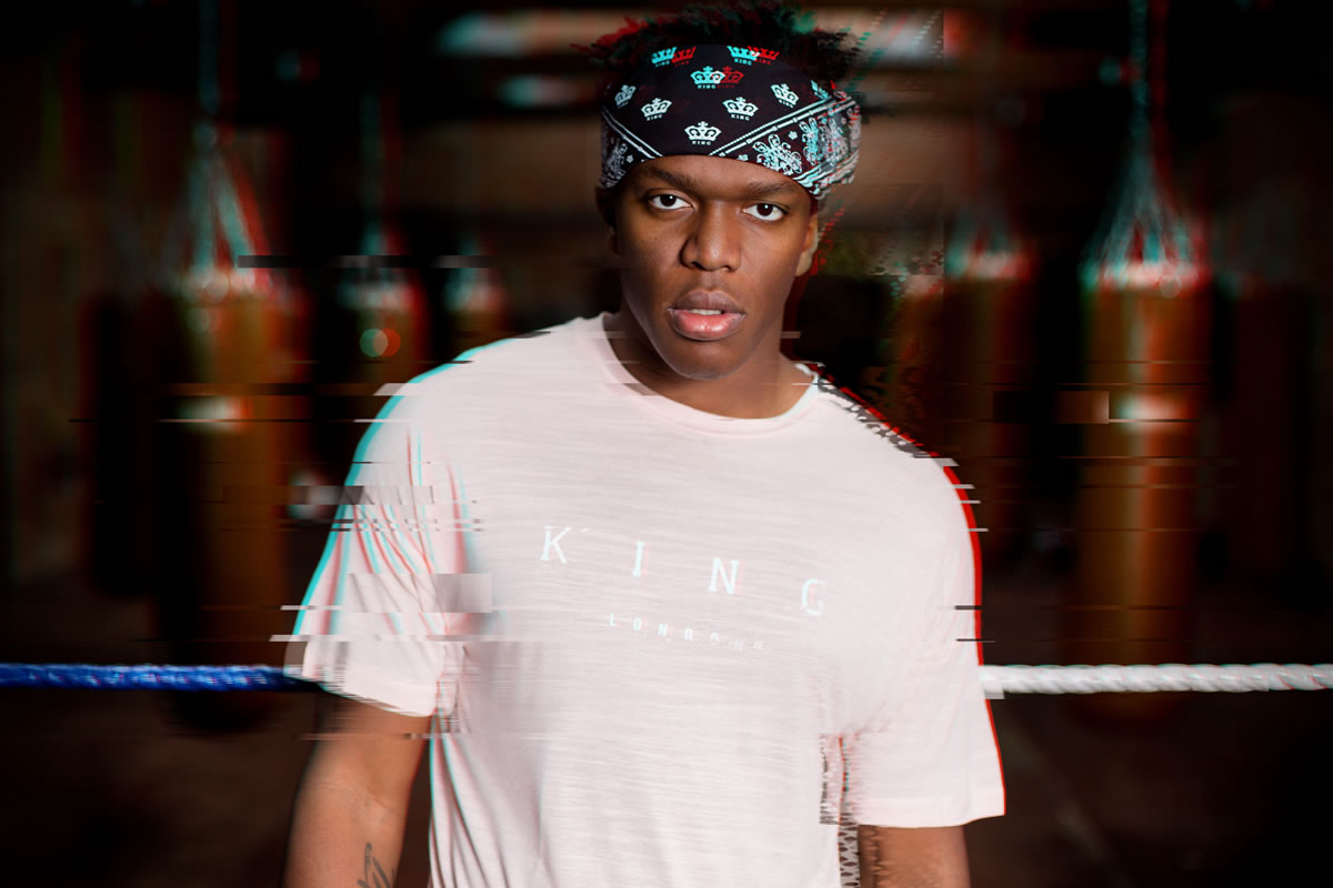 KSI wearing black King Apparel tracksuit