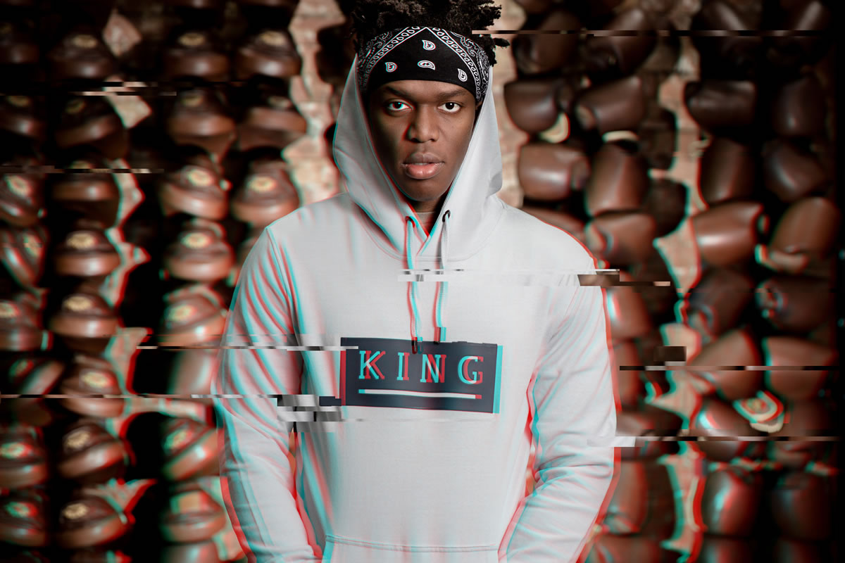 KSI wearing black King Apparel jacket