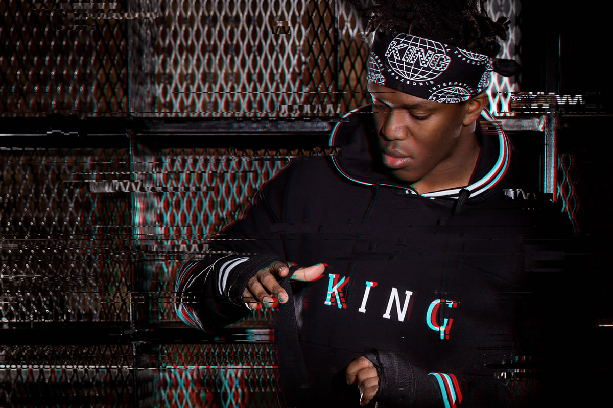 KSI wearing black King Apparel long-sleeve t-shirt