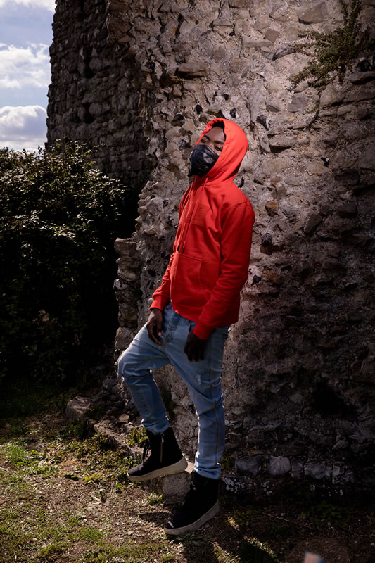 Fire Chulo wearing King Apparel crimson Manor hoodie and E15 jeans