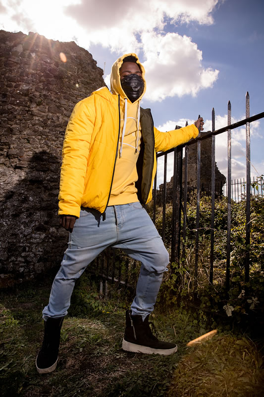 Fire Chulo wearing King Apparel citrus Blackwall down jacket and citrus Stepney hoodie