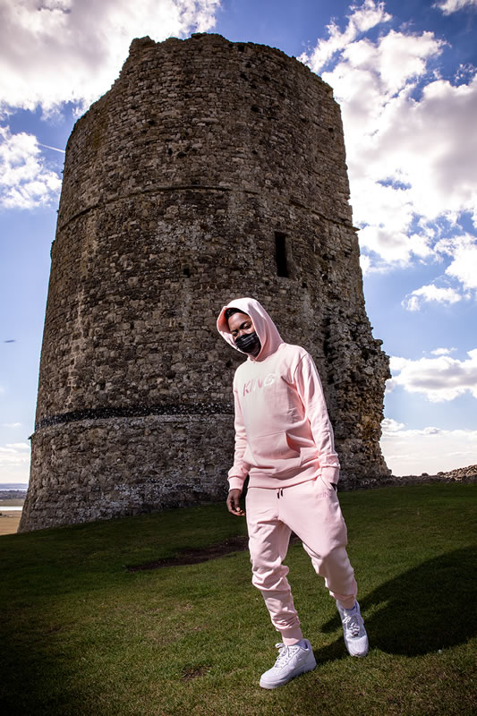 Fire Chulo wearing King Apparel blush Wapping tracksuit
