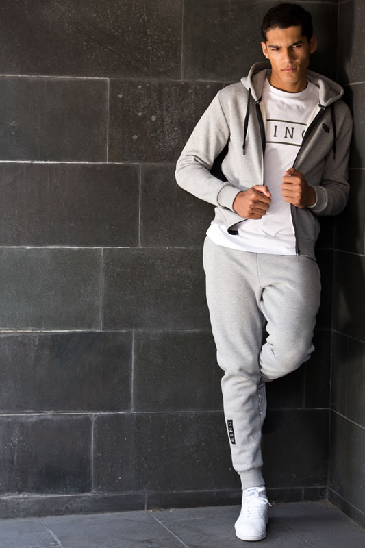Model wearing stone SS17 King Apparel tracksuit