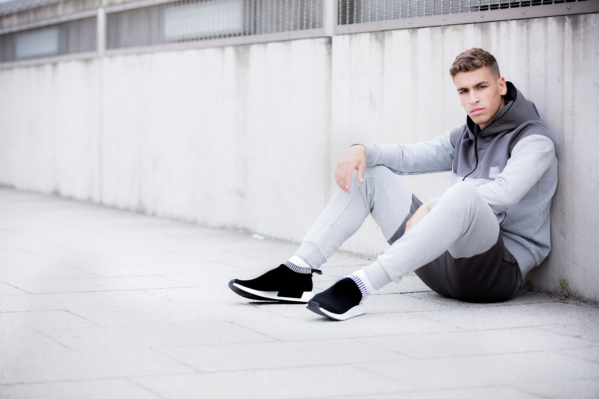 Model wearing grey SS18 King Apparel tracksuit