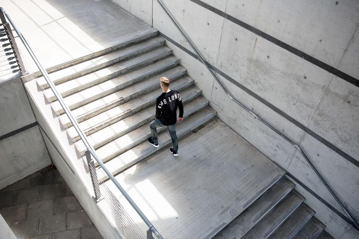 Model wearing black SS18 King Apparel sweatshirt
