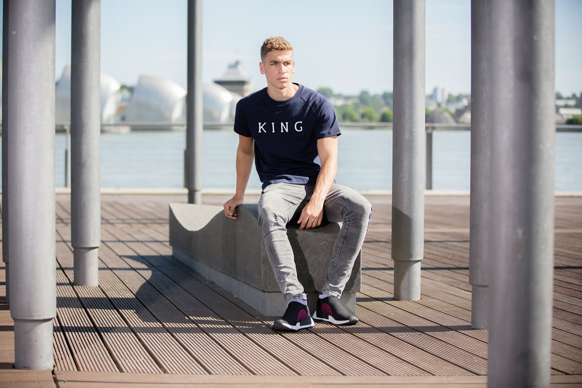 Model wearing navy SS18 King Apparel t-shirt