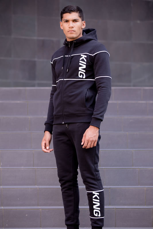 Model wearing black SS19 King Apparel Manor tracksuit