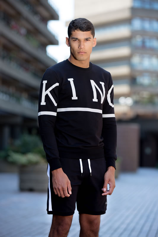 Model wearing black SS19 King Apparel Leyton trackset