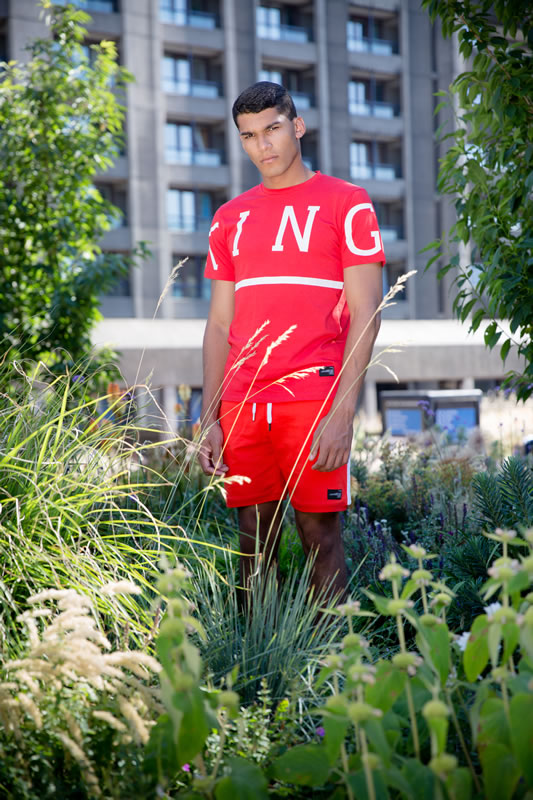 Model wearing crimson SS19 King Apparel Leyton t-shirt trackset