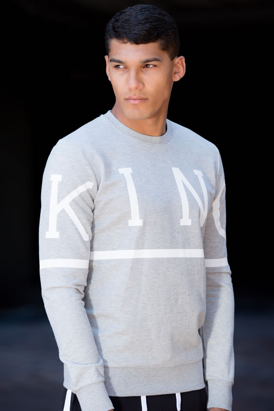Model wearing stone SS19 King Apparel Leyton sweatshirt