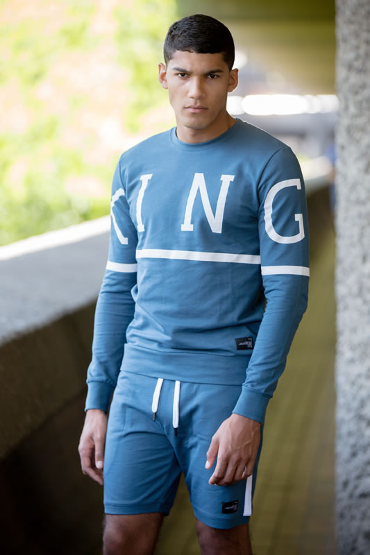 Model wearing ink SS19 King Apparel Leyton trackset