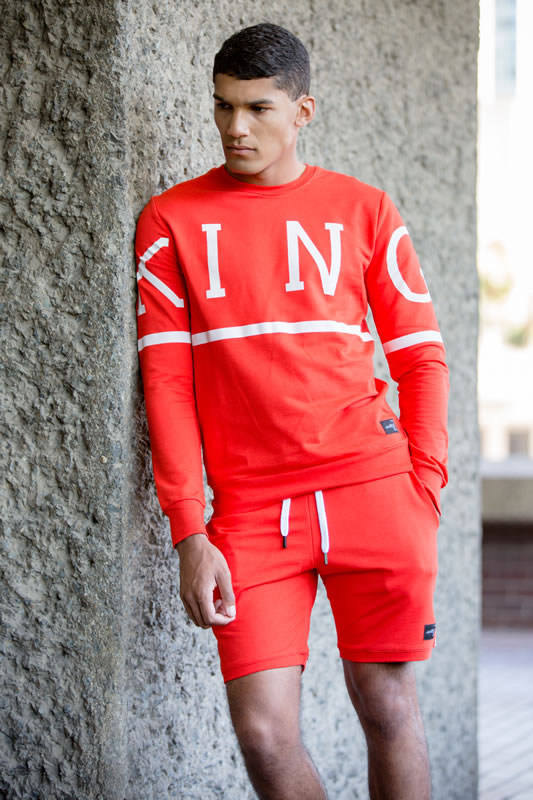 Model wearing crimson SS19 King Apparel Leyton trackset