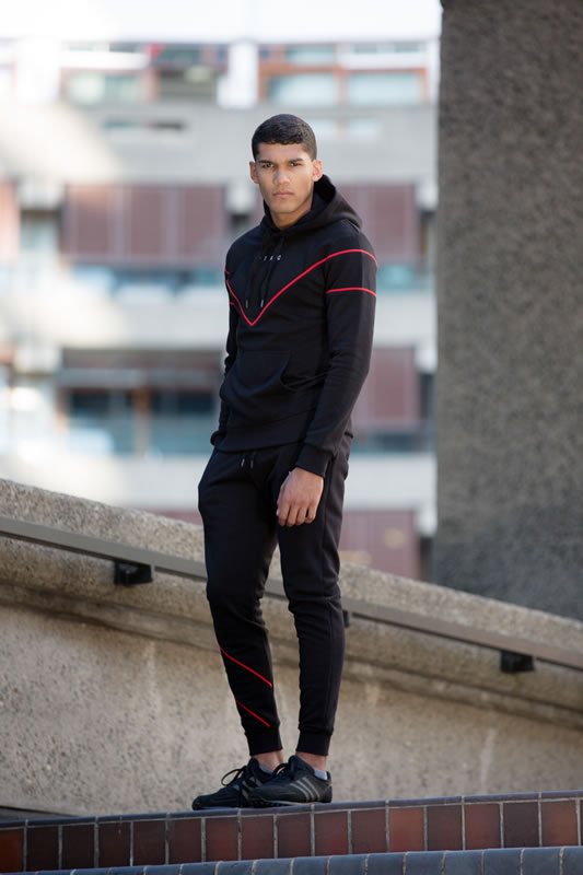 Model wearing black SS19 King Apparel Tennyson tracksuit