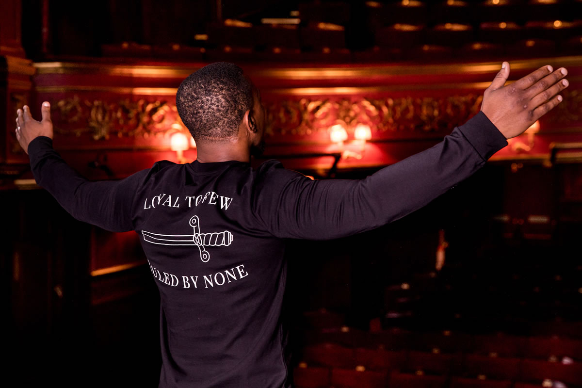 Ashley Walters wearing King Apparel ink Bethnal cap and ink Bethnal sweatshirt