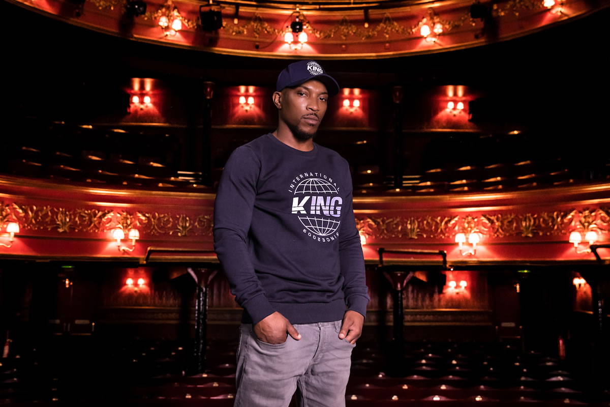 Ashley Walters wearing King Apparel crimson Manor hoodie