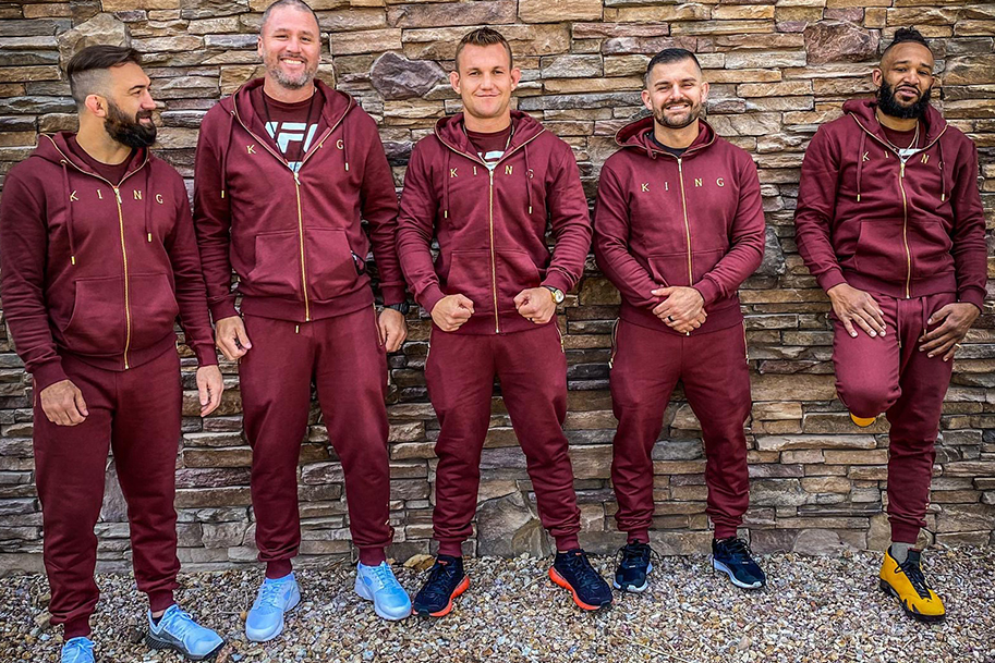 Ian Heinisch and team in the Tennyson Gold tracksuit